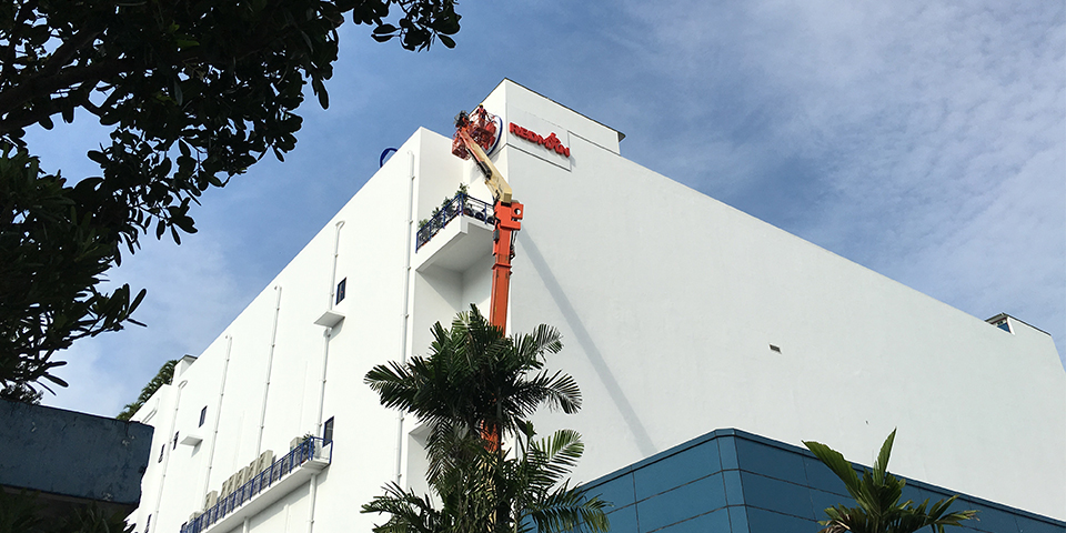 Installation of REDMAN Building Facade Sign