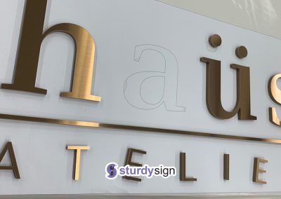 Haus Atelier 3d acrylic signage with pvd coated stainless steel overlay